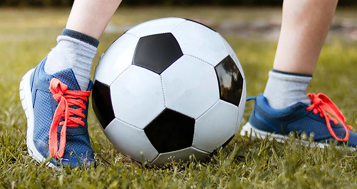 Mitigating Concussions - child playing soccer